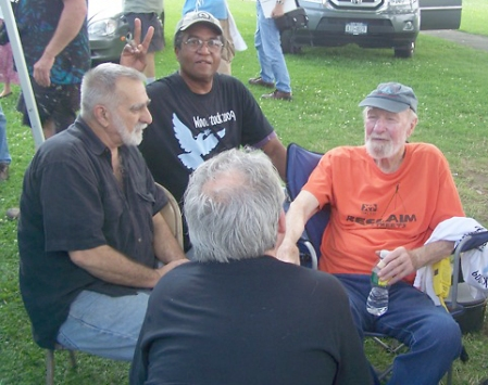 Clockwise from left: Phil Sauer, Pierre LeRoy, Pete Seeger, C. Williams