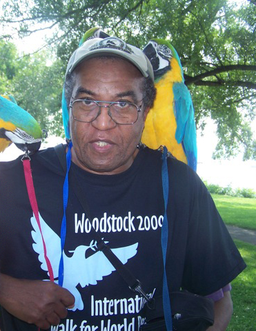 Pierre with 2 parrots for peace (actually Blue-and-yellow Macaws)